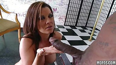 Milf with big round tits sucking and licking balls