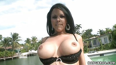 Big tits Diamond Kitty showing off her bare boobs outdoors