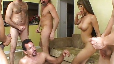Asian whore Lucy Thai prepares for a gang bang with double penetration anal