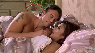 Asian Kaylani Lei laying on the bed and spreading her pussy