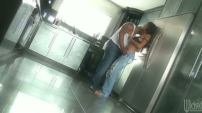 Ebony milf Evanni Solei undressing and showing tits in kitchen
