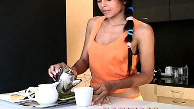 Teenie cutie Carina18 making some drinks in the kitchen in her panties