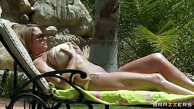 Big tits latina Eva Notty having a tan and getting oil on tits outdoors