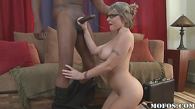 Milf on her knees eating and sucking black shaft